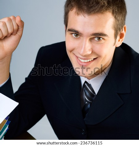 Cheerful smiling happy student or young businessman - stock photo