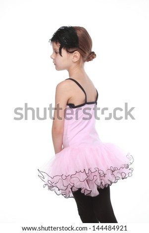 Cheerful smiling little girl in a tutu dancing on isolated white on Beauty and Fashion - stock photo
