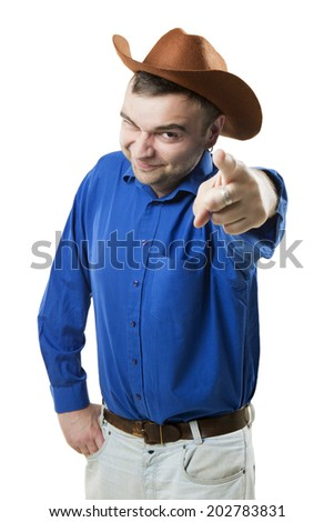 Cheerful smiling positive cowboy stares into the camera and points to you. Wild wild West - stock photo