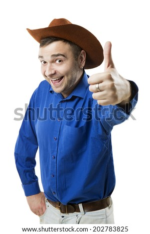 Cheerful smiling positive guy in cowboy hat showing sign thumb up finger. - stock photo