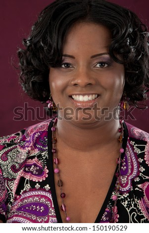 Cheerful Smiling Young African American Plus Size  Woman on Dark Background - stock photo