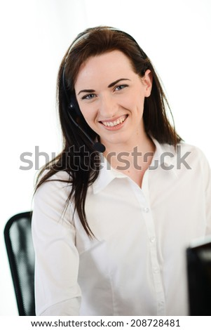 cheerful smiling young female telephone customer support hotline service talking on the phone with a client - stock photo