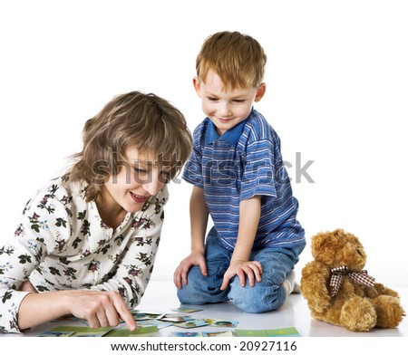 Cheerful son plays with mother - stock photo