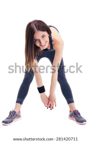 Cheerful sporty woman doing stretching exercise isolated on a white background. Looking at camera - stock photo