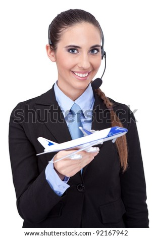 cheerful stewardess holding plane in her hand, information about flying