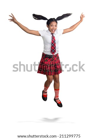 Cheerful student jumping on white background - stock photo