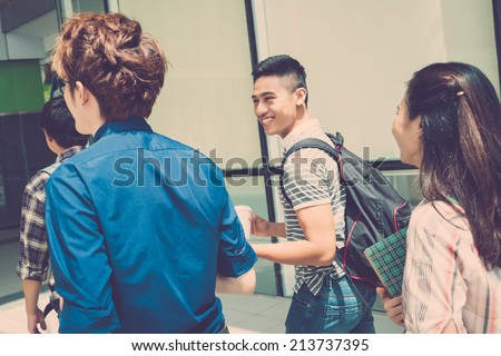 Cheerful students going to school - stock photo