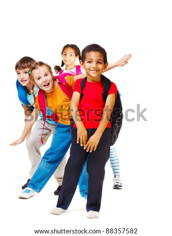 Cheerful students of elementary age, over white - stock photo