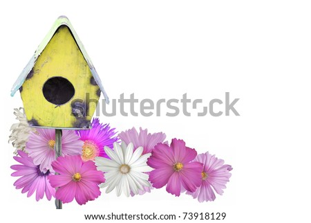 Cheerful summer border of a painted bird house surrounded by flowers isolated on white - stock photo