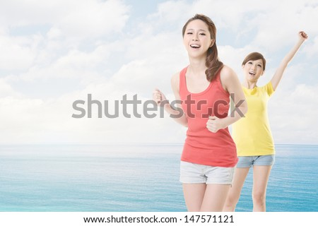 Cheerful summer girls near the sea, closeup portrait with two woman and copyspace. - stock photo
