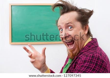 Cheerful teacher at the blackboard - stock photo