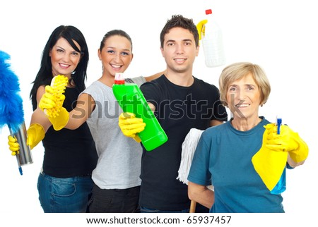 Cheerful team  of cleaning service workers showing  their products for clean house isolated on white background - stock photo
