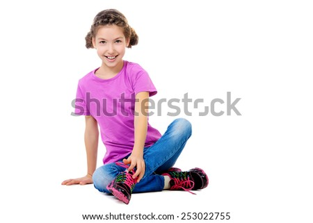 Cheerful teen girl wearing casual clothes. Active lifestyle. Studio shot. Isolated over white. - stock photo