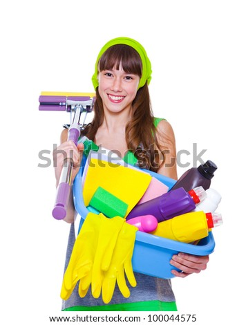 Cheerful teen holding detergents and mop - stock photo