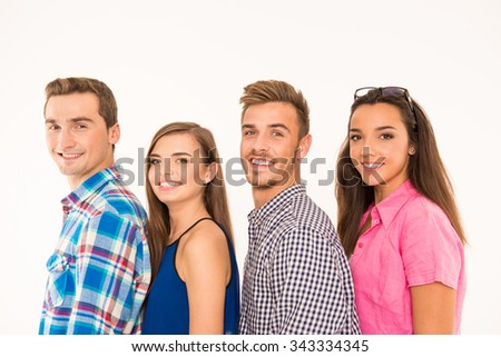 Cheerful teen people standing in a line