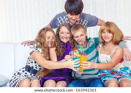 Cheerful teenage friends at a New Year party - stock photo