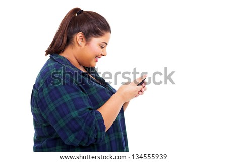 cheerful teenage girl chatting on her cell phone over white background - stock photo