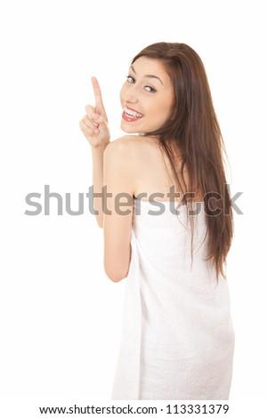 cheerful teenage girl pointing up, white background - stock photo