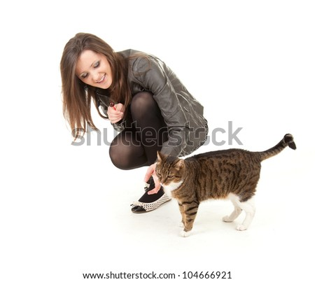 cheerful teenage girl  with her lovely cat, full length, white background - stock photo