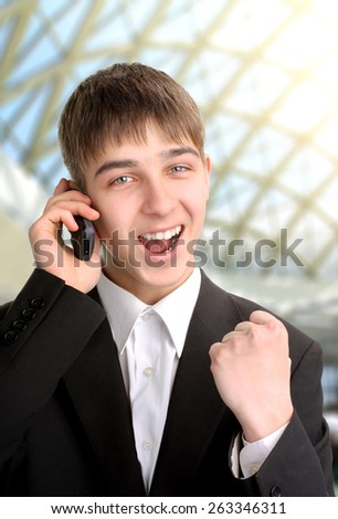 cheerful teenager get a good news on the phone - stock photo