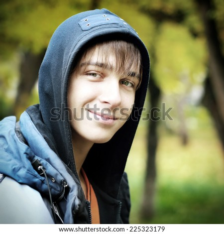 Cheerful Teenager in the Autumn Park - stock photo