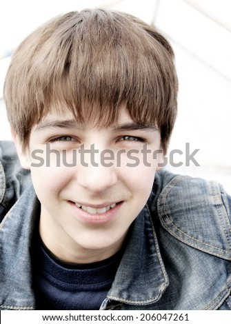 Cheerful Teenager Portrait closeup outdoor - stock photo
