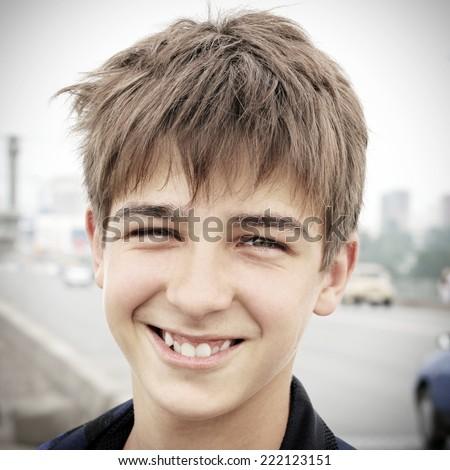 Cheerful Teenager Portrait on the City Street - stock photo