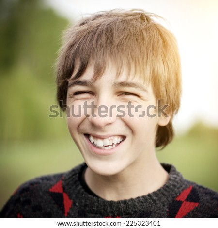 Cheerful Teenager Portrait on the Nature Background - stock photo