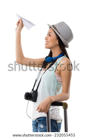 Cheerful tourist holding paper plane, side view - stock photo