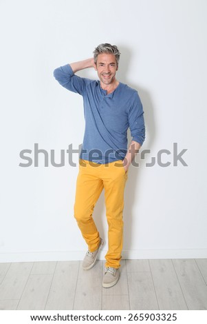 Cheerful trendy mature man on white backgound - stock photo