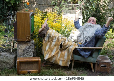 Cheerful TV fans - stock photo
