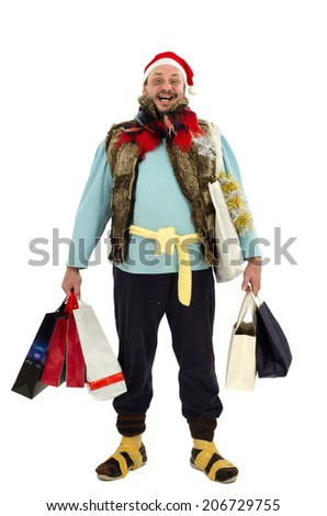 Cheerful vagrant is feeling so happy with Christmas shopping bags - stock photo