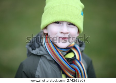 Cheerful warmly dressed boy portrait - stock photo