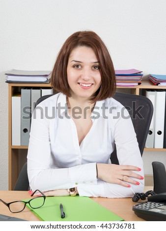 Cheerful woman call centre employee wearing white shirt and glasses - stock photo