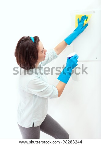 Cheerful woman cleaning
