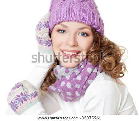 Cheerful woman clothing in warm hat. Winter season. - stock photo