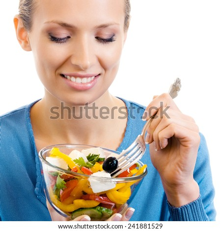 Cheerful woman eating salad, isolated over white background - stock photo