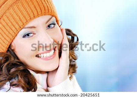 Cheerful woman face clothing in warm orange hat. Winter season. - stock photo