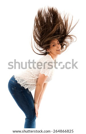Cheerful woman flipping her hair while dancing isolated on white background - stock photo