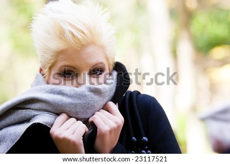 Cheerful woman in cold gesture - stock photo