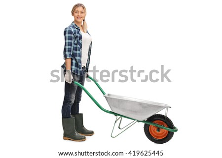 Cheerful woman posing with an empty wheelbarrow isolated on white background - stock photo