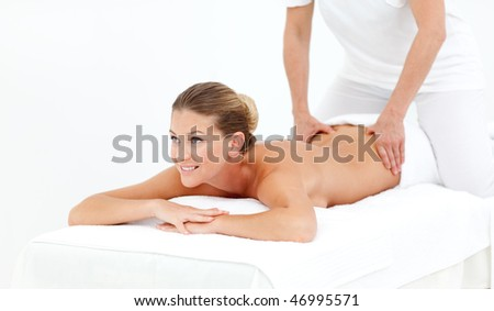 Cheerful woman receiving a massage in a hotel - stock photo