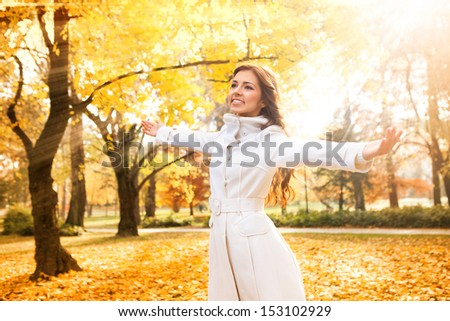 Cheerful woman relaxing in beautiful autumn day, concept �¢?? freedom - stock photo