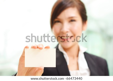 Cheerful woman showing business card