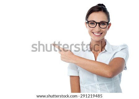 Cheerful woman showing empty copy space - stock photo