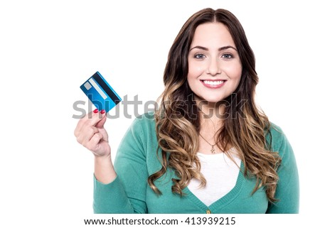 Cheerful woman showing her new credit card - stock photo