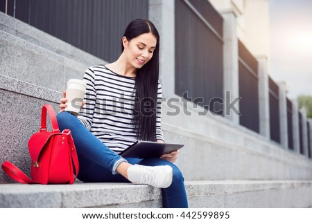 Cheerful woman sitting on the footsteps