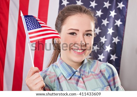 Cheerful woman with american flag,concept  independence day - stock photo