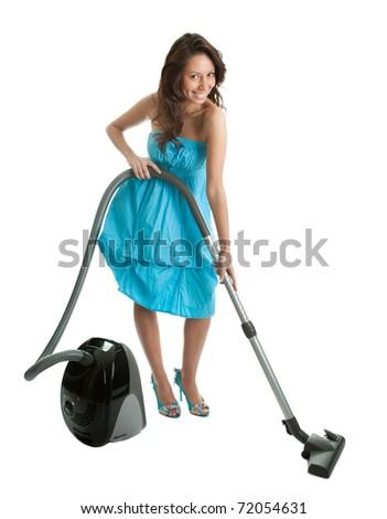 Cheerful woman with handheld vacuum cleaner - stock photo