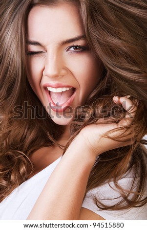 cheerful woman with opened mouth and long hair - stock photo